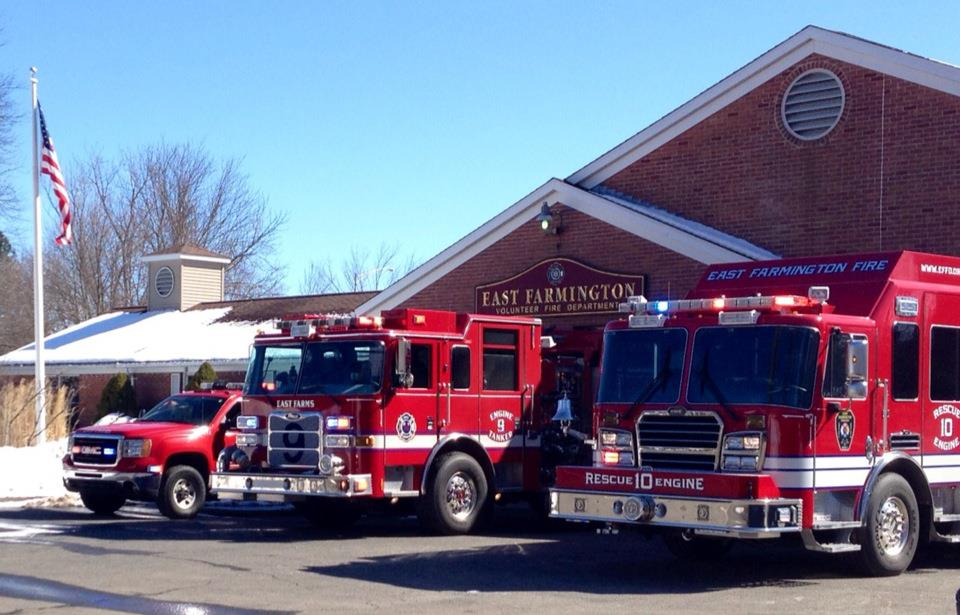 Medic 11, Engine 9 and Engine 10 in front of the East Farmington Fire Station.